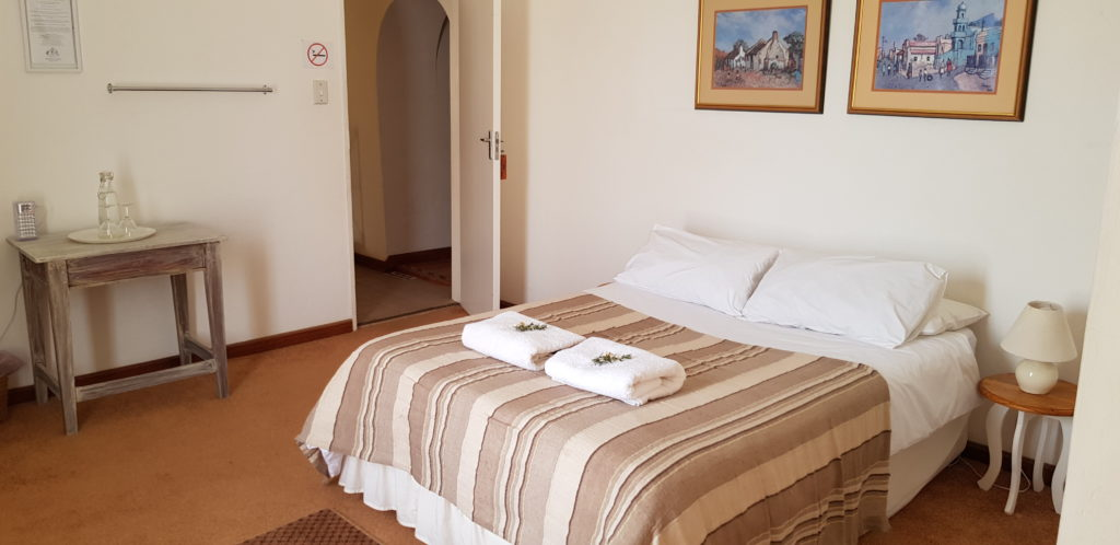 ROOM 1 HAS A DOUBLE BED AND SHARES A BATHROOM WITH ROOM 2. PRIVATE USE OF THE BATHROOM IS AVAILABLE AT AN EXTRA R50 PER NIGHT.