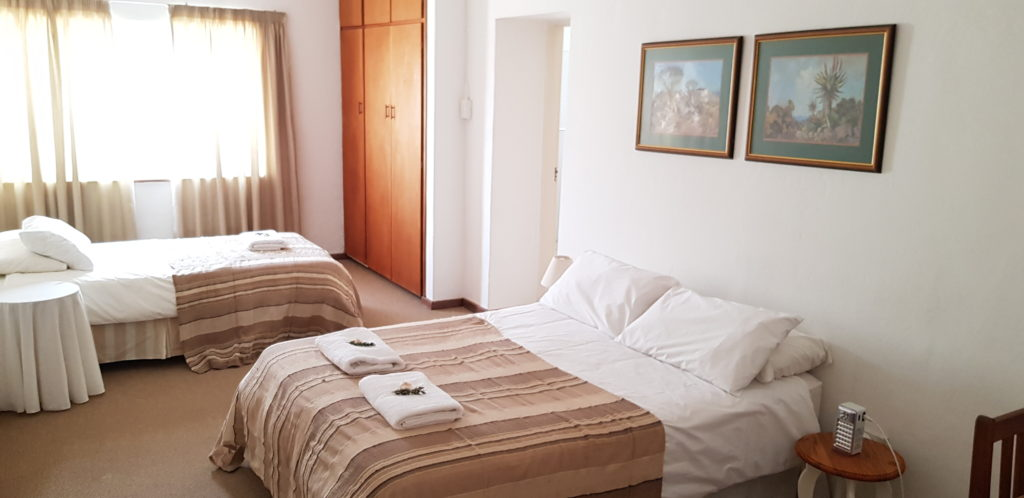 ROOM 2 HAS A DOUBLE BED AND A SINGLE BED, AND SHARES A BATHROOM WITH ROOM 1. PRIVATE USE OF THE BATHROOM IS AVAILABLE AT AN EXTRA R50 PER NIGHT.